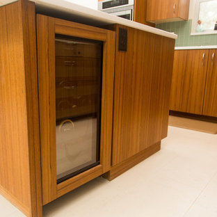 Inspiration for a midcentury l-shaped kitchen in Other with flat-panel cabinets, medium wood cabinets and with island.