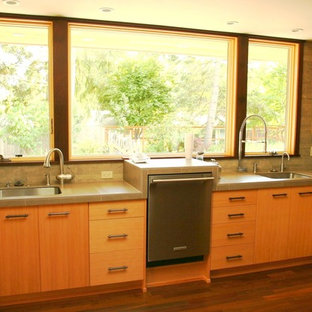 Design ideas for a mid-sized midcentury u-shaped open plan kitchen in Other with an undermount sink, flat-panel cabinets, medium wood cabinets, concrete benchtops, grey splashback, cement tile splashback, stainless steel appliances, dark hardwood floors and no island.