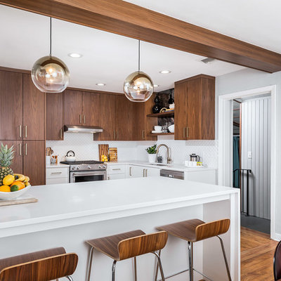 Inspiration for a small 1960s l-shaped brown floor and medium tone wood floor eat-in kitchen remodel in Miami with flat-panel cabinets, quartz countertops, white backsplash, mosaic tile backsplash, stainless steel appliances, a peninsula, an undermount sink, medium tone wood cabinets and white countertops