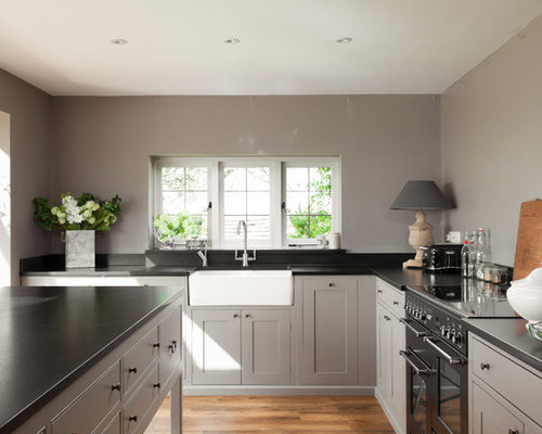 Kitchen Black Floor Grey Walls White Cabinets photo - 6