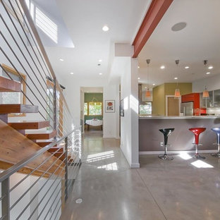 Design ideas for a large midcentury u-shaped eat-in kitchen in Raleigh with flat-panel cabinets, red cabinets, quartz benchtops, stainless steel appliances, concrete floors, a peninsula and grey floor.