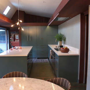 Inspiration for a midcentury galley eat-in kitchen in San Francisco with an integrated sink, flat-panel cabinets, green cabinets, quartz benchtops, white splashback, panelled appliances, concrete floors and with island.