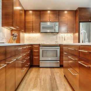 Design ideas for a large midcentury eat-in kitchen in Portland with a double-bowl sink, flat-panel cabinets, medium wood cabinets, quartz benchtops, white splashback, marble splashback, stainless steel appliances, bamboo floors, with island, brown floor and white benchtop.