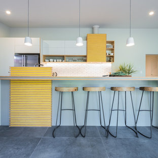 Design ideas for a large midcentury galley eat-in kitchen in Adelaide with an undermount sink, flat-panel cabinets, grey cabinets, laminate benchtops, white splashback, ceramic splashback, stainless steel appliances, ceramic floors and with island.