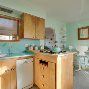 Inspiration for a mid-sized midcentury u-shaped eat-in kitchen in Portland with a drop-in sink, flat-panel cabinets, light wood cabinets, laminate benchtops, blue splashback, white appliances, linoleum floors, a peninsula and turquoise floor.
