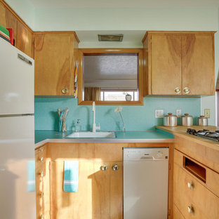 Mid-sized midcentury u-shaped eat-in kitchen in Portland with a drop-in sink, flat-panel cabinets, light wood cabinets, laminate benchtops, blue splashback, white appliances, linoleum floors, a peninsula and turquoise floor.