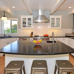 This is an example of a mid-sized midcentury u-shaped separate kitchen in San Francisco with a single-bowl sink, shaker cabinets, white cabinets, marble benchtops, white splashback, ceramic splashback, stainless steel appliances, terra-cotta floors and with island.