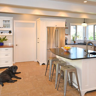 Design ideas for a mid-sized midcentury u-shaped separate kitchen in San Francisco with a single-bowl sink, shaker cabinets, white cabinets, marble benchtops, white splashback, ceramic splashback, stainless steel appliances, terra-cotta floors and with island.