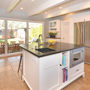 Mid-sized mid-century modern enclosed kitchen ideas - Mid-sized 1950s u-shaped terra-cotta tile enclosed kitchen photo in San Francisco with a single-bowl sink, shaker cabinets, white cabinets, marble countertops, white backsplash, ceramic backsplash, stainless steel appliances and an island