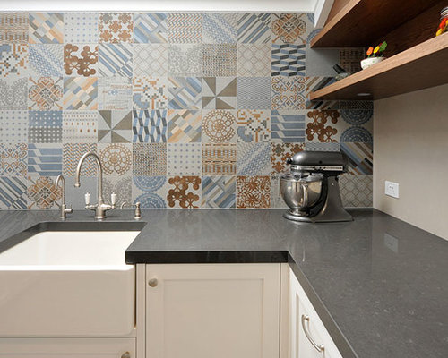 ushaped eatin kitchen idea in melbourne with a farmhouse sink
