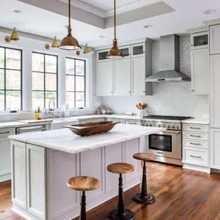 Transitional kitchen appliance - Kitchen - transitional l-shaped dark wood floor and brown floor kitchen idea in Atlanta with a farmhouse sink, recessed-panel cabinets, white cabinets, white backsplash, stainless steel appliances, an island and white countertops