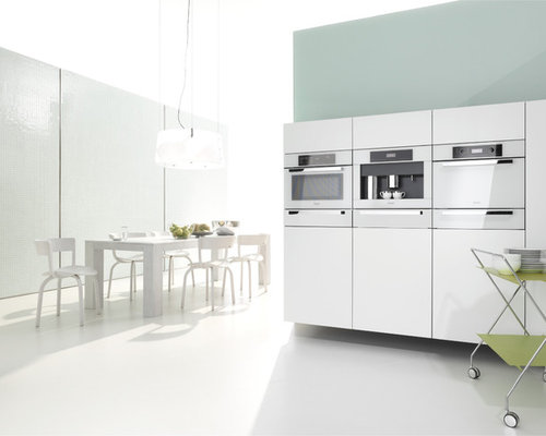 inspiration for a contemporary eat in kitchen remodel with white appliances
