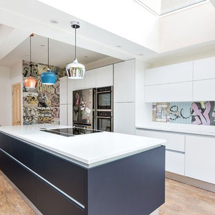 Design ideas for a contemporary single-wall kitchen in Other with flat-panel cabinets, white cabinets, light hardwood flooring and an island.