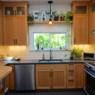 Small farmhouse enclosed kitchen designs - Example of a small farmhouse u-shaped linoleum floor enclosed kitchen design in Portland with an undermount sink, shaker cabinets, light wood cabinets, concrete countertops, white backsplash, ceramic backsplash, stainless steel appliances and no island