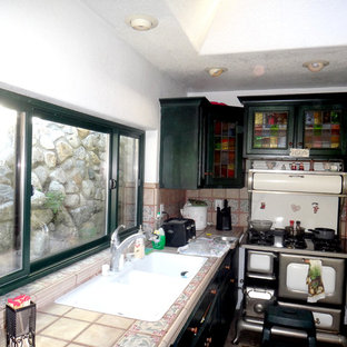 Eat-in kitchen in Los Angeles with a triple-bowl sink, green cabinets, tile benchtops and white appliances.