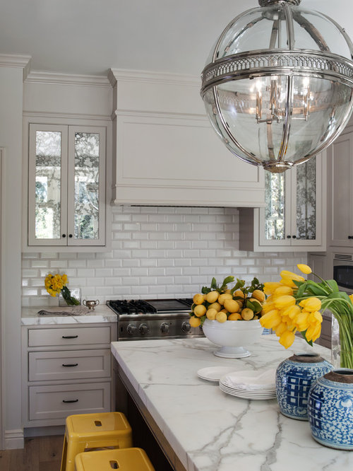 Mirrored Kitchen Cabinets. Example of an ornate kitchen design in San Francisco with marble  countertops beaded inset cabinets Mirrored Cabinet Doors Houzz