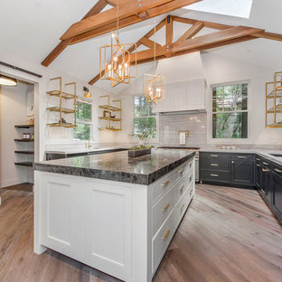 Inspiration for a mid-sized transitional u-shaped eat-in kitchen in San Francisco with an undermount sink, open cabinets, grey splashback, with island, beige floor, black cabinets, marble benchtops, stone slab splashback, panelled appliances and medium hardwood floors.
