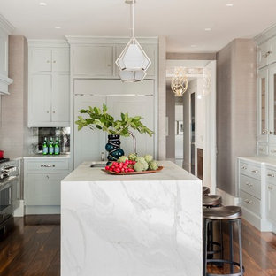 Mid-sized contemporary enclosed kitchen ideas - Example of a mid-sized trendy medium tone wood floor enclosed kitchen design in Boston with an undermount sink, gray cabinets, stainless steel appliances, an island, recessed-panel cabinets, metallic backsplash, metal backsplash and marble countertops