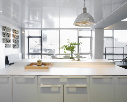 Example Of A Trendy Kitchen Design In Seattle With Flat Panel Cabinets