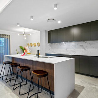 Large contemporary galley kitchen pantry in Perth with an undermount sink, black cabinets, quartz benchtops, white splashback, marble splashback, porcelain floors, with island, grey floor and white benchtop.