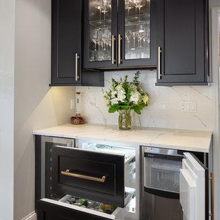 Mini fridge drawers and ice maker in bar