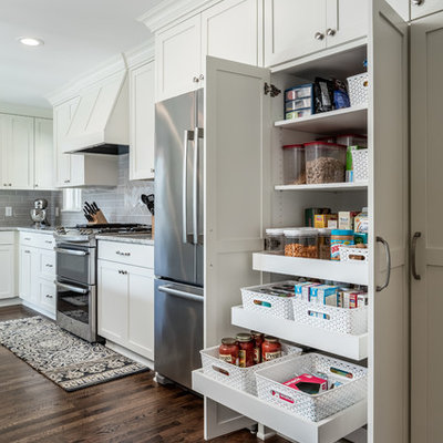 Kitchen pantry - mid-sized traditional dark wood floor kitchen pantry idea in Minneapolis with an undermount sink, shaker cabinets, white cabinets, granite countertops, gray backsplash, subway tile backsplash and stainless steel appliances