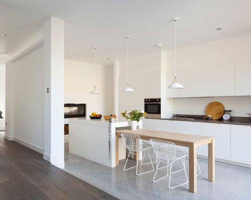 Cucina scandinava con pavimento in cemento foto e idee for Piastrelle paraspruzzi cucina