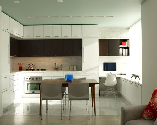 example of a minimalist l shaped open concept kitchen design in new york with stainless