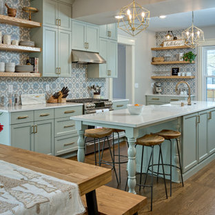 Photo of a mid-sized transitional galley eat-in kitchen in Minneapolis with shaker cabinets, green cabinets, quartz benchtops and with island.