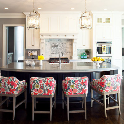 Example of a classic dark wood floor kitchen design in Minneapolis with white cabinets, stone tile backsplash, multicolored backsplash, recessed-panel cabinets, stainless steel appliances and an island