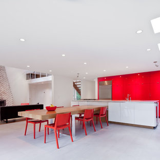 Example of a minimalist kitchen design in Minneapolis with stainless steel appliances and red cabinets