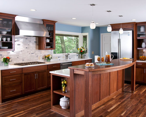 Inspiration for a contemporary kitchen remodel in Minneapolis with  stainless steel appliances, wood countertops,