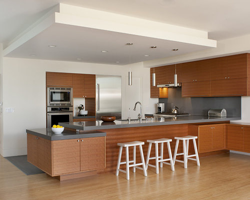 ... steel appliances, flat-panel cabinets and medium tone wood cabinets