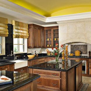 Ispirazione per una cucina mediterranea con lavello stile country, ante di vetro, ante in legno bruno, paraspruzzi multicolore, paraspruzzi con piastrelle a mosaico, elettrodomestici in acciaio inossidabile e 2 o più isole