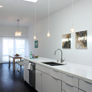 Example of a minimalist kitchen design in San Francisco with stainless steel appliances