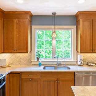 Large arts and crafts l-shaped eat-in kitchen in Boston with beige splashback, subway tile splashback, stainless steel appliances, an undermount sink, shaker cabinets, medium wood cabinets, granite benchtops, marble floors, with island and white floor.