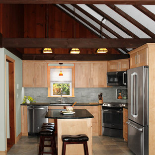 Photo of a small transitional u-shaped open plan kitchen in Boston with an undermount sink, shaker cabinets, light wood cabinets, soapstone benchtops, grey splashback, ceramic splashback, stainless steel appliances, porcelain floors, with island, multi-coloured floor and black benchtop.