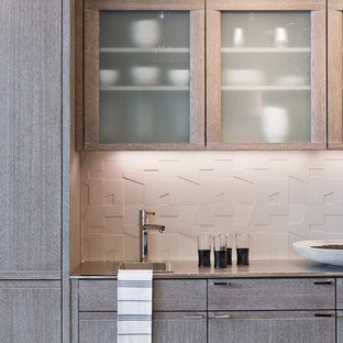 Inspiration for a contemporary kitchen remodel in Boston with glass-front cabinets, light wood cabinets, white backsplash and porcelain backsplash