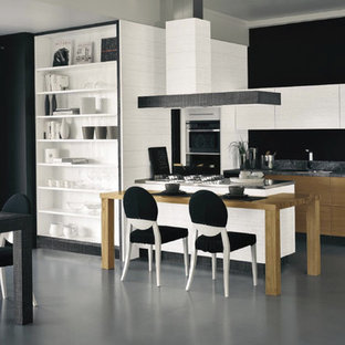 This is an example of a contemporary eat-in kitchen in London with flat-panel cabinets and medium wood cabinets.