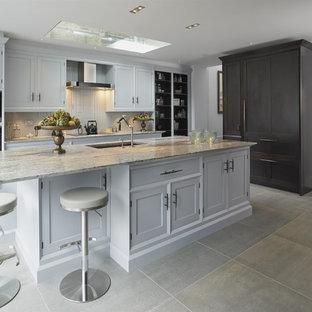 Medium sized classic kitchen in London with an island, a submerged sink, grey cabinets, granite worktops, grey floors, shaker cabinets and black appliances.