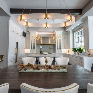 Inspiration for a transitional u-shaped eat-in kitchen in Chicago with shaker cabinets, white cabinets, recycled glass benchtops, white splashback, porcelain splashback, with island and green benchtop.