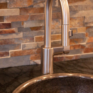 Craftsman eat-in kitchen photos - Inspiration for a craftsman dark wood floor eat-in kitchen remodel in Cleveland with a drop-in sink, shaker cabinets, dark wood cabinets, soapstone countertops, brown backsplash, stainless steel appliances and two islands