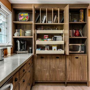 Idéer för att renovera ett mellanstort amerikanskt l-kök, med släta luckor, skåp i rostfritt stål, bänkskiva i betong, rostfria vitvaror, ljust trägolv och en köksö
