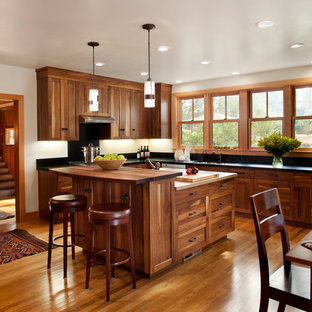 Mid-sized trendy u-shaped medium tone wood floor eat-in kitchen photo in San Francisco with wood countertops, an undermount sink, shaker cabinets, medium tone wood cabinets, stainless steel appliances and an island