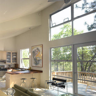 Midcentury modern open concept kitchen designs - Example of a 1960s open concept kitchen design in San Francisco with flat-panel cabinets and light wood cabinets