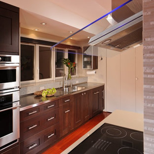 Contemporary kitchen inspiration - Example of a trendy medium tone wood floor and brown floor kitchen design in Hawaii with a triple-bowl sink, shaker cabinets, dark wood cabinets, quartzite countertops, beige backsplash, matchstick tile backsplash, stainless steel appliances and an island