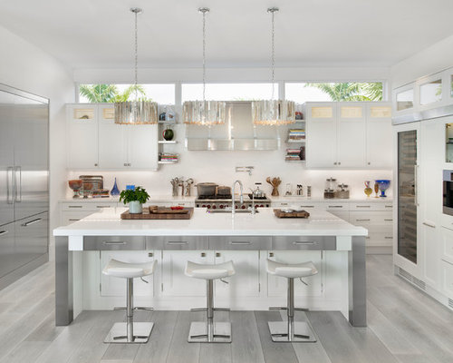 Beach Style Kitchen Designs   Example Of A Coastal U Shaped Light Wood  Floor And