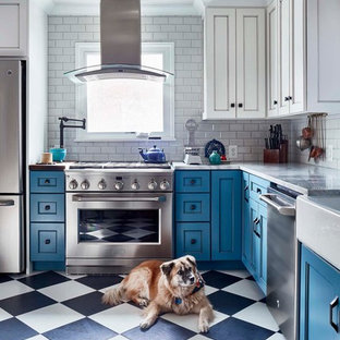 Design ideas for a mid-sized traditional l-shaped separate kitchen in Other with a farmhouse sink, recessed-panel cabinets, blue cabinets, white splashback, subway tile splashback, stainless steel appliances, multi-coloured floor, quartz benchtops, porcelain floors and no island.
