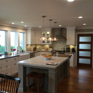 Kitchen - farmhouse medium tone wood floor kitchen idea in San Francisco with a farmhouse sink, shaker cabinets, white cabinets, quartz countertops, green backsplash, porcelain backsplash, stainless steel appliances and an island