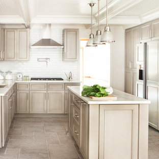 Large transitional kitchen ideas - Inspiration for a large transitional u-shaped ceramic tile kitchen remodel in Atlanta with an undermount sink, recessed-panel cabinets, beige cabinets, white backsplash, subway tile backsplash, paneled appliances, an island and marble countertops